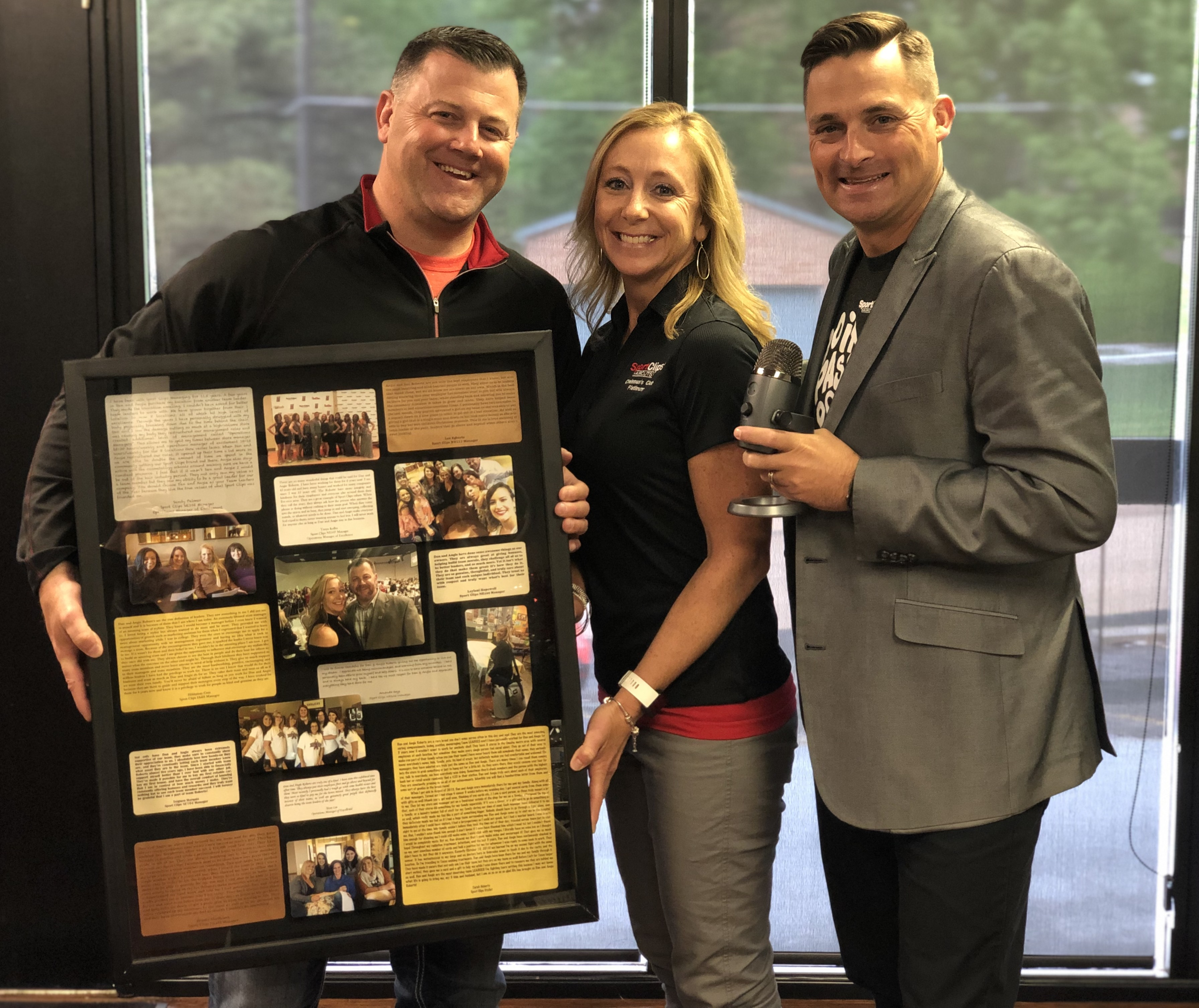 Chad Jordan with Dan and Angie Roberts holding a shadow box of photos