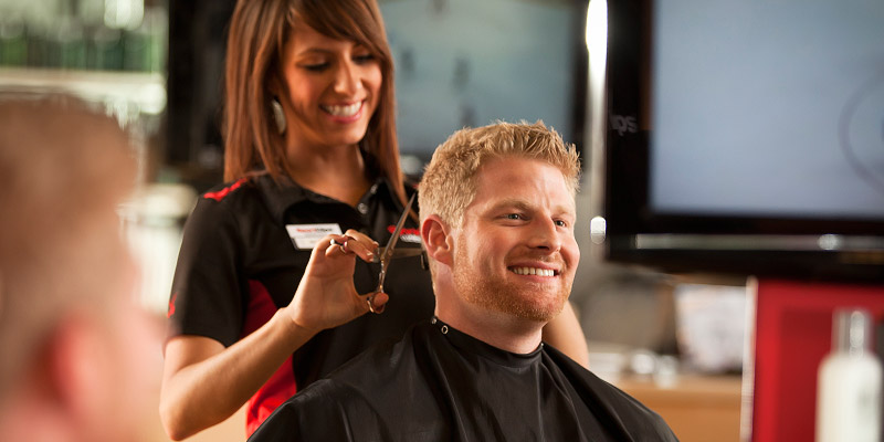 Image of a guy getting a sport clips haircut